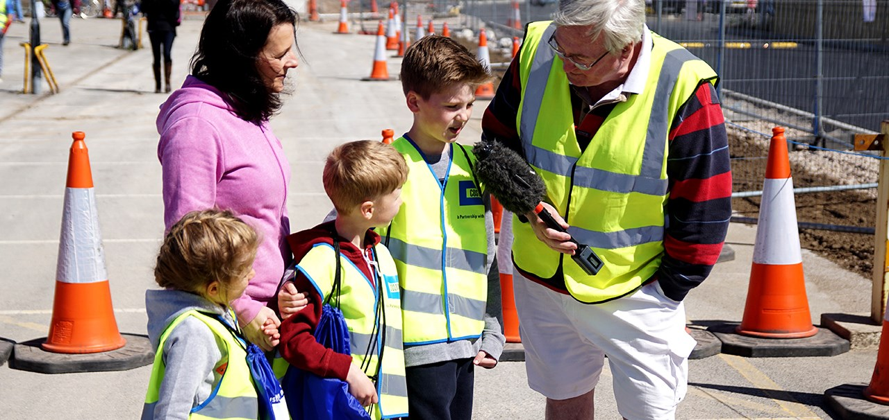 Family being interviewed about Costain's Welly Walk