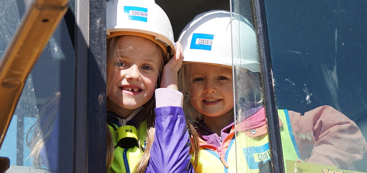 Two young girls wearing PPE